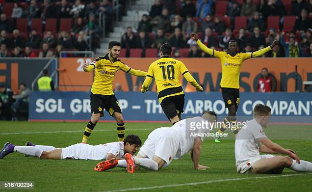 Henrikh Mkhitaryan of Dortmung celebrates his first goal with teammates Nuri Sahin and Ramos Vasquez during the Bundesliga match between FC Augsburg...