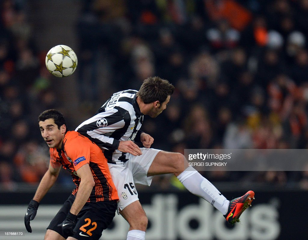 Henrikh Mkhitaryan (L) of FC Shakhtar Donetsk fights for the ball with Andrea Barzagli of Juventus during their UEFA Champions League football match in Donetsk on December 5, 2012. Juventus won 1-0.