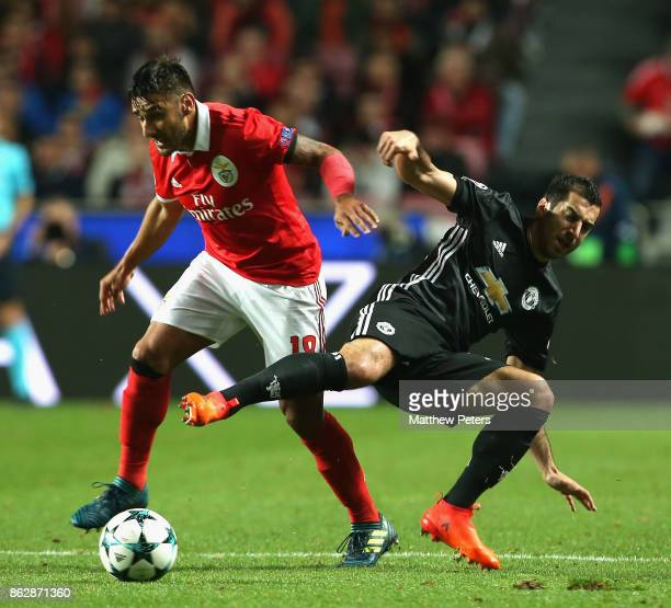 Henrikh Mkhitaryan of Mancester United in action with Eduardo Salvio of Benfica during the UEFA Champions League group A match between SL Benfica and...
