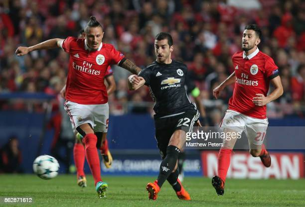Henrikh Mkhitaryan of Mancester United in action with Ljubomir Fejsa of Benfica during the UEFA Champions League group A match between SL Benfica and...