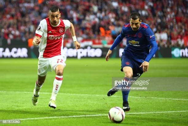 Henrikh Mkhitaryan of Manchester United and Hakim Ziyech of Ajax in action during the UEFA Europa League Final between Ajax and Manchester United at...