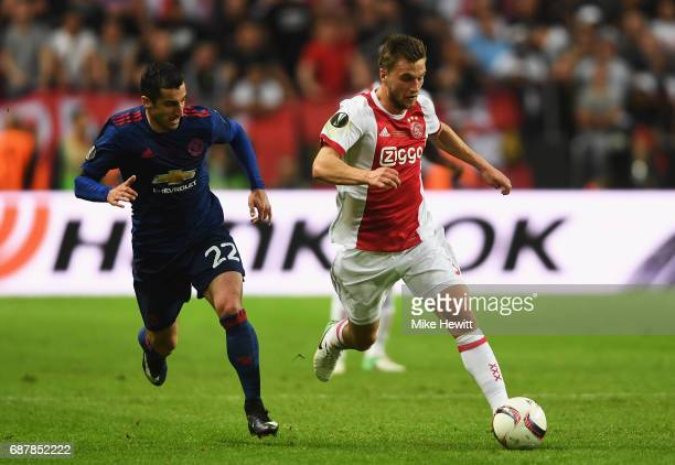 Henrikh Mkhitaryan of Manchester United and Joel Veltman of Ajax in action during the UEFA Europa League Final between Ajax and Manchester United at...