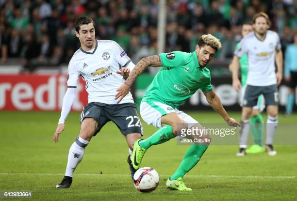 Henrikh Mkhitaryan of Manchester United and Kevin Malcuit of SaintEtienne in action during the UEFA Europa League Round of 32 second leg match...