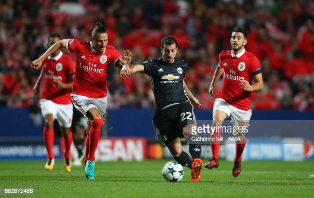Henrikh Mkhitaryan of Manchester United battles with Ljubomir Fejsa and Pizzi of Benfica during the UEFA Champions League group A match between SL...