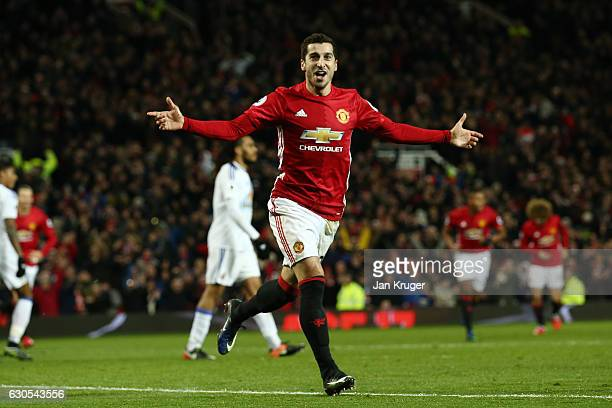 Henrikh Mkhitaryan of Manchester United celebrates after scoring his team's third goal during the Premier League match between Manchester United and...
