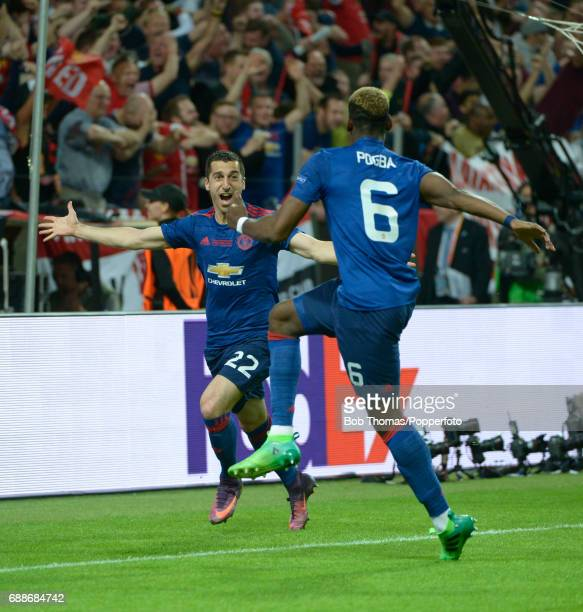 Henrikh Mkhitaryan of Manchester United celebrates after scoring the second goal with teammate Paul Pogba during the UEFA Europa League final between...