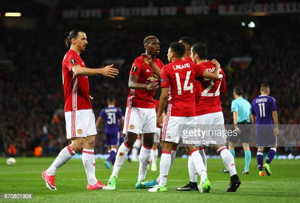 Henrikh Mkhitaryan of Manchester United celebrates as he scores their first goal with team matesduring the UEFA Europa League quarter final second...