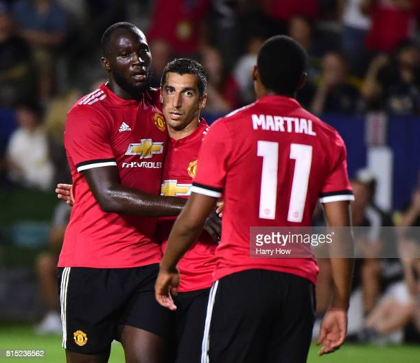 Henrikh Mkhitaryan of Manchester United celebrates his goal with Romelo Lukaku and Anthony Martial to take a 40 lead over the Los Angeles Galaxy...