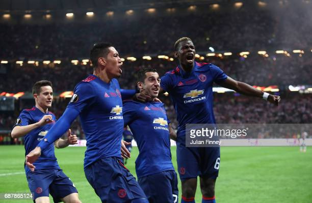 Henrikh Mkhitaryan of Manchester United celebrates scoring his sides second goal with Chris Smalling of Manchester United and Paul Pogba of...