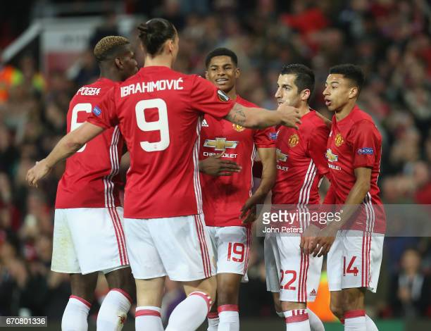 Henrikh Mkhitaryan of Manchester United celebrates scoring their first goal during the UEFA Europa League quarter final second leg match between...