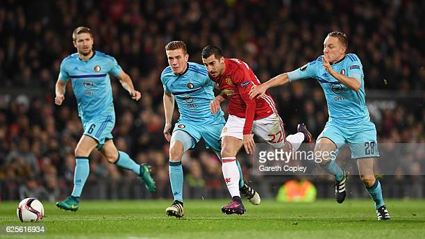 Henrikh Mkhitaryan of Manchester United goes between Jens Toornstra and Wessel Dammers of Feyenoord during the UEFA Europa League Group A match...