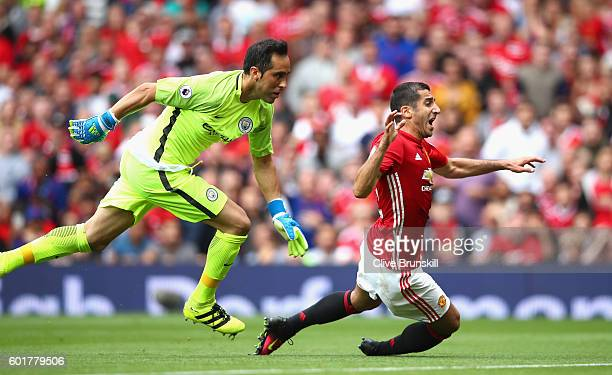 Henrikh Mkhitaryan of Manchester United goes down while under pressure from Claudio Bravo of Manchester City during the Premier League match between...