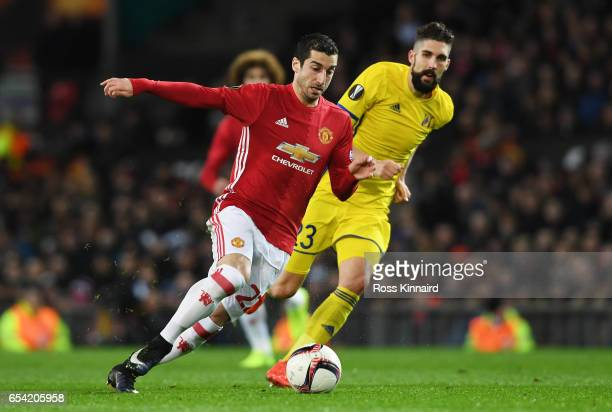 Henrikh Mkhitaryan of Manchester United goes past Miha Mevlja of FC Rostov during the UEFA Europa League Round of 16 second leg match between...