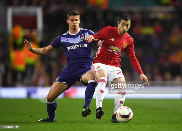 Henrikh Mkhitaryan of Manchester United holds off Leander Dendoncker of RSC Anderlecht during the UEFA Europa League quarter final second leg match...