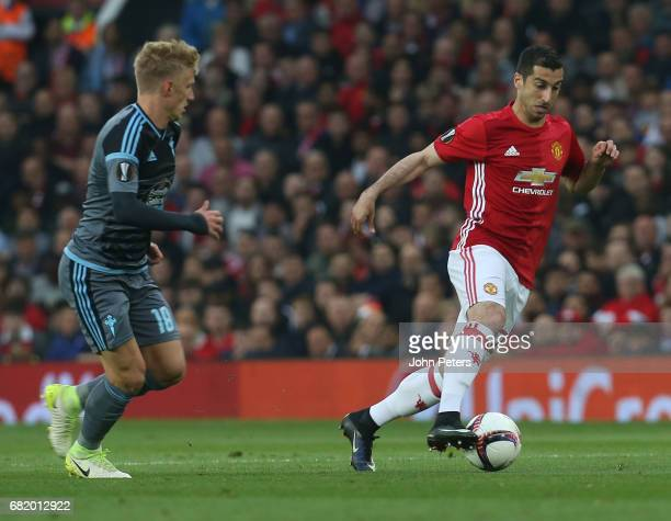 Henrikh Mkhitaryan of Manchester United in action with Daniel Wass of Celta Vigo during the UEFA Europa League semi final second leg match between...