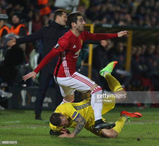 Henrikh Mkhitaryan of Manchester United in action with Fedor Kudryashov of FK Rostov during the UEFA Europa League Round of 16 first leg match...