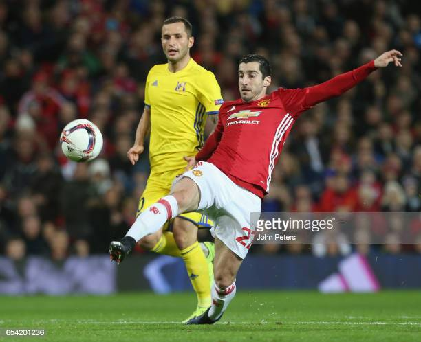 Henrikh Mkhitaryan of Manchester United in action with Fedor Kudryashov of FK Rostov during the UEFA Europa League Round of 16 second leg match...