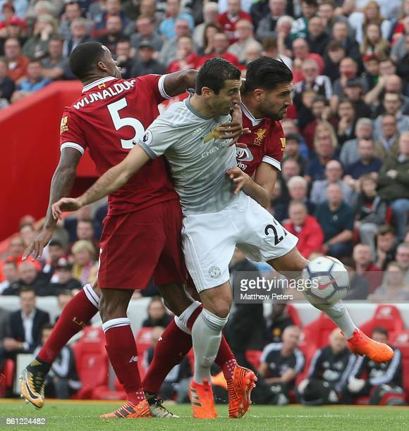 Henrikh Mkhitaryan of Manchester United in action with Georginio Wijnaldum and Emre Can of Liverpool during the Premier League match between...