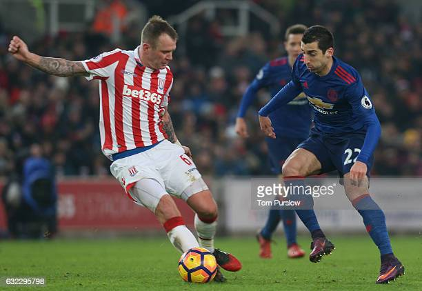 Henrikh Mkhitaryan of Manchester United in action with Glenn Whelan of Stoke City during the Premier League match between Stoke City and Manchester...