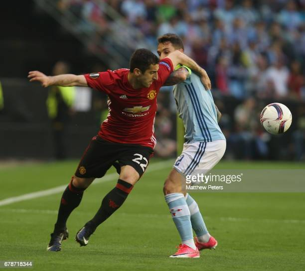 Henrikh Mkhitaryan of Manchester United in action with Hugo Mallo of Celta Vigo during the UEFA Europa League semifinal first leg match between Celta...