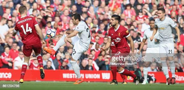 Henrikh Mkhitaryan of Manchester United in action with Jordan Henderson of Liverpool during the Premier League match between Liverpool and Manchester...