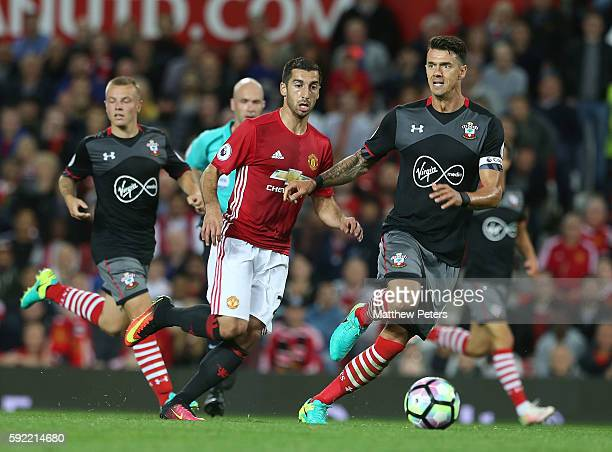 Henrikh Mkhitaryan of Manchester United in action with Jose Fonte of Southampton during the Premier League match between Manchester United and...