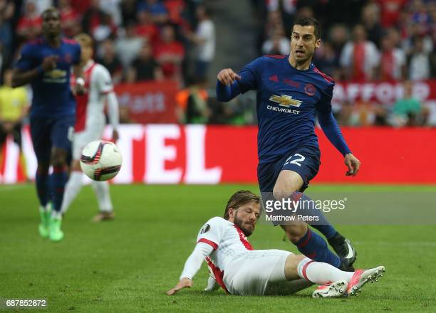 Henrikh Mkhitaryan of Manchester United in action with Lasse Schone of Ajax during the UEFA Europa League Final match between Manchester United and...