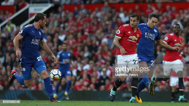 Henrikh Mkhitaryan of Manchester United in action with Matty James of Leicester City during the Premier League match between Manchester United and...