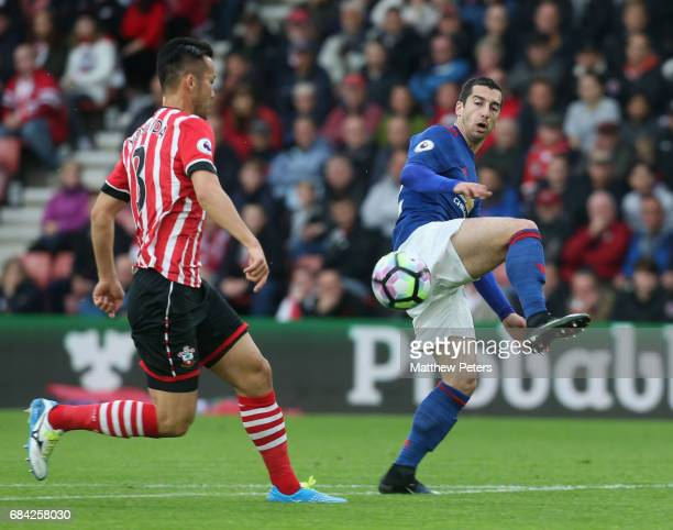 Henrikh Mkhitaryan of Manchester United in action with Maya Yoshida of Southampton during the Premier League match between Southampton and Manchester...