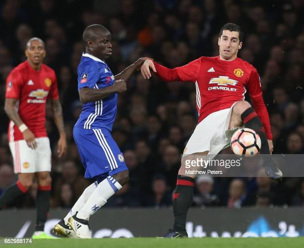 Henrikh Mkhitaryan of Manchester United in action with Ngolo Kante of Chelsea during the Emirates FA Cup QuarterFinal match between Chelsea and...