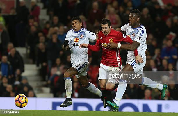 Henrikh Mkhitaryan of Manchester United in action with Patrick van Aanholt and Lamine Kone of Sunderland during the Premier League match between...