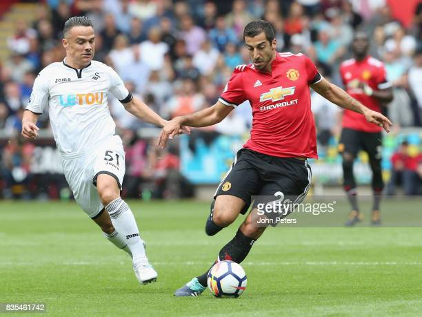 Henrikh Mkhitaryan of Manchester United in action with Roque Mesa of Swansea City during the Premier League match between Swansea City and Manchester...