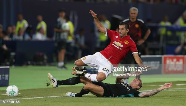 Henrikh Mkhitaryan of Manchester United in action with Toni Kroos of Real Madrid during the UEFA Super Cup match between Real Madrid and Manchester...