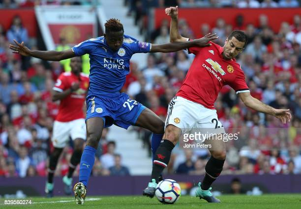 Henrikh Mkhitaryan of Manchester United in action with Wilfred Ndidi of Leicester City during the Premier League match between Manchester United and...