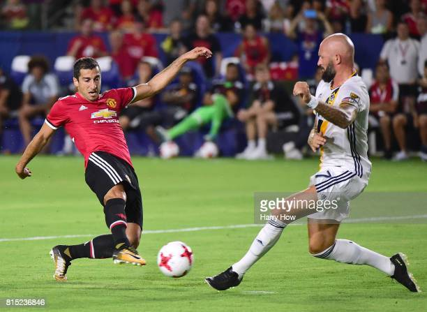 Henrikh Mkhitaryan of Manchester United is challenged for the ball by Jelle Van Damme of Los Angeles Galaxy during a 52 United victory at StubHub...
