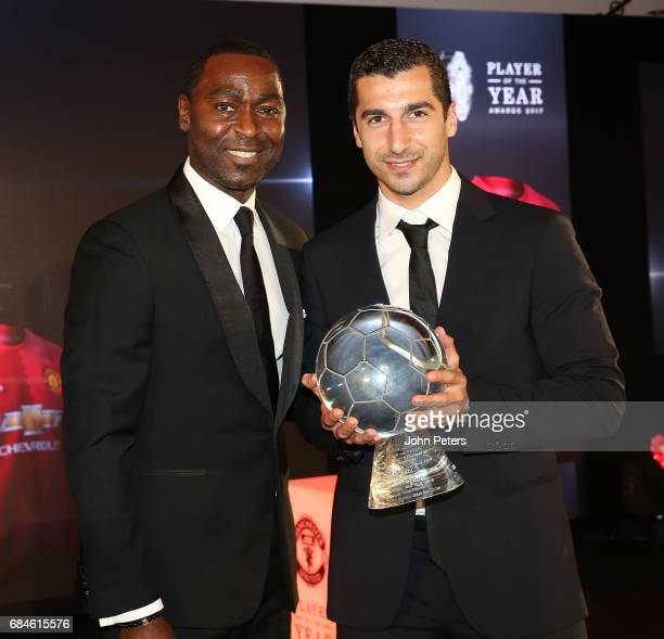 Henrikh Mkhitaryan of Manchester United is presented with the Goal of the Year award for his goal against Sunderland by former player Andy Cole at...