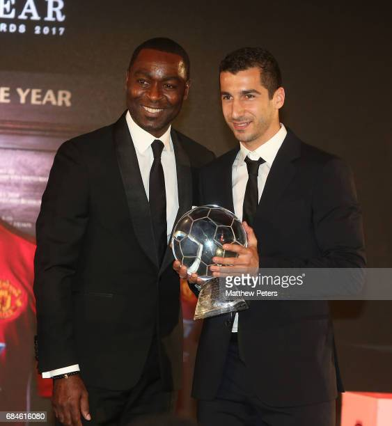 Henrikh Mkhitaryan of Manchester United is presented with the Goal of the Year award for his goal against Sunderland by former player Andy Cole the...