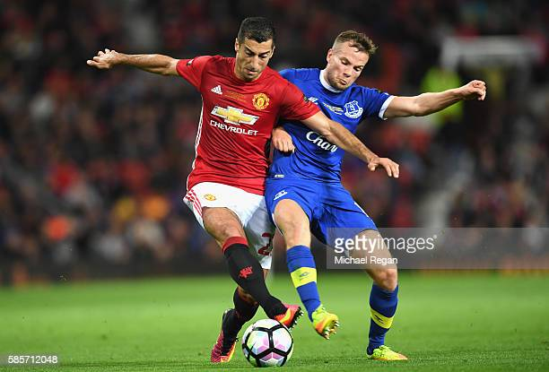 Henrikh Mkhitaryan of Manchester United is tackled by Tom Cleverly of Everton during the Wayne Rooney Testimonial match between Manchester United and...
