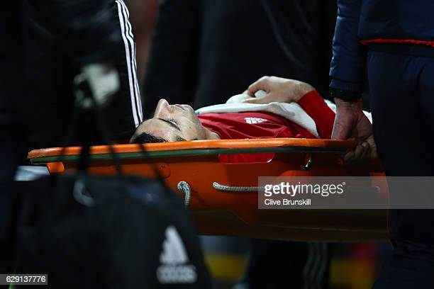 Henrikh Mkhitaryan of Manchester United is taken off by a stretcher after the challenge by Danny Rose of Tottenham Hotspur during the Premier League...