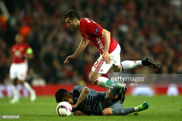 Henrikh Mkhitaryan of Manchester United jumps over a challenge from Pablo Hernandez of Celta Vigo during the UEFA Europa League semi final second leg...