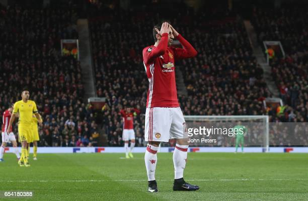 Henrikh Mkhitaryan of Manchester United reacts to a missed chance during the UEFA Europa League Round of 16 second leg match between Manchester...