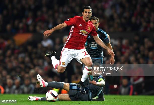 Henrikh Mkhitaryan of Manchester United rides a tackle from Pablo Hernandez of Celta Vigo during the UEFA Europa League semi final second leg match...
