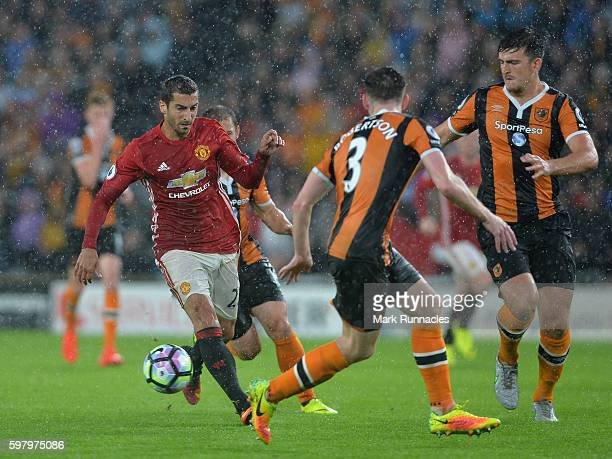 Henrikh Mkhitaryan of Manchester United runs with the ball at the Hull City defence during the Premier League match between Manchester United FC and...
