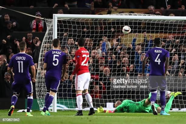 Henrikh Mkhitaryan of Manchester United scores the first goal to make the score 10 during the UEFA Europa League quarter final second leg match...