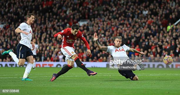 Henrikh Mkhitaryan of Manchester United scores the opening goal during the Premier League match between Manchester United and Tottenham Hotspur at...