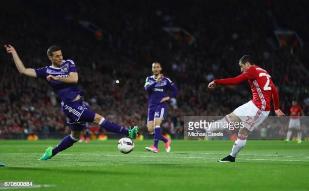 Henrikh Mkhitaryan of Manchester United scores their first goal during the UEFA Europa League quarter final second leg match between Manchester...