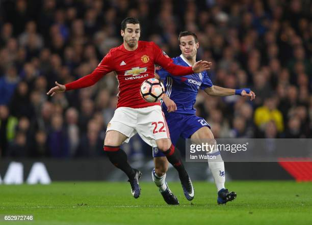 Henrikh Mkhitaryan of Manchester United shields the ball from Cesar Azpilicueta of Chelsea during The Emirates FA Cup QuarterFinal match between...