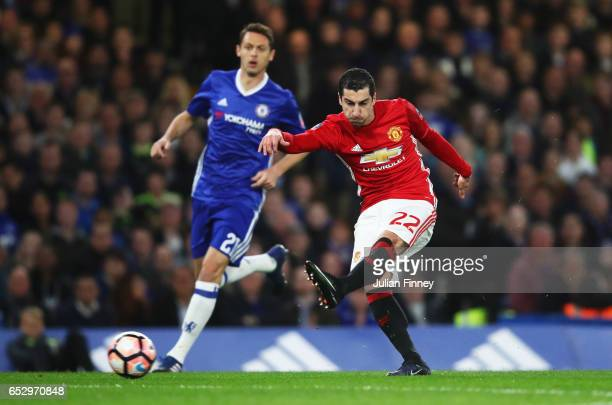 Henrikh Mkhitaryan of Manchester United shoots as Nemanja Matic of Chelsea looks on during The Emirates FA Cup QuarterFinal match between Chelsea and...