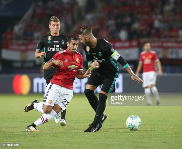 Henrikh Mkhitaryan of Manchester United vies Sergio Ramos of Real Madrid during the UEFA Super Cup match between Real Madrid and Manchester United at...