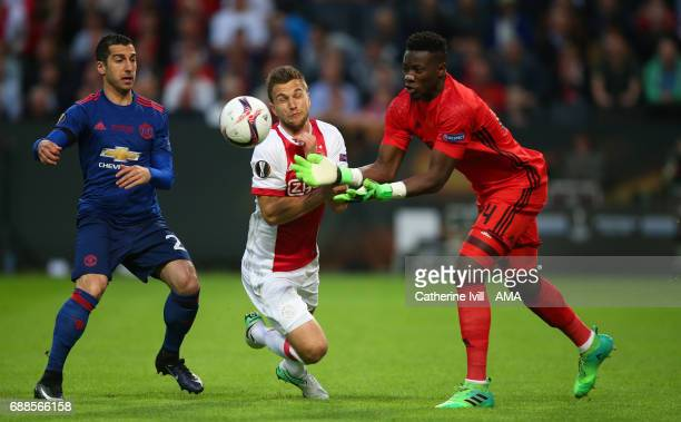Henrikh Mkhitaryan of Manchester United watches as Joel Veltman of Ajax and Andre Onana of Ajax collide during the UEFA Europa League Final match...